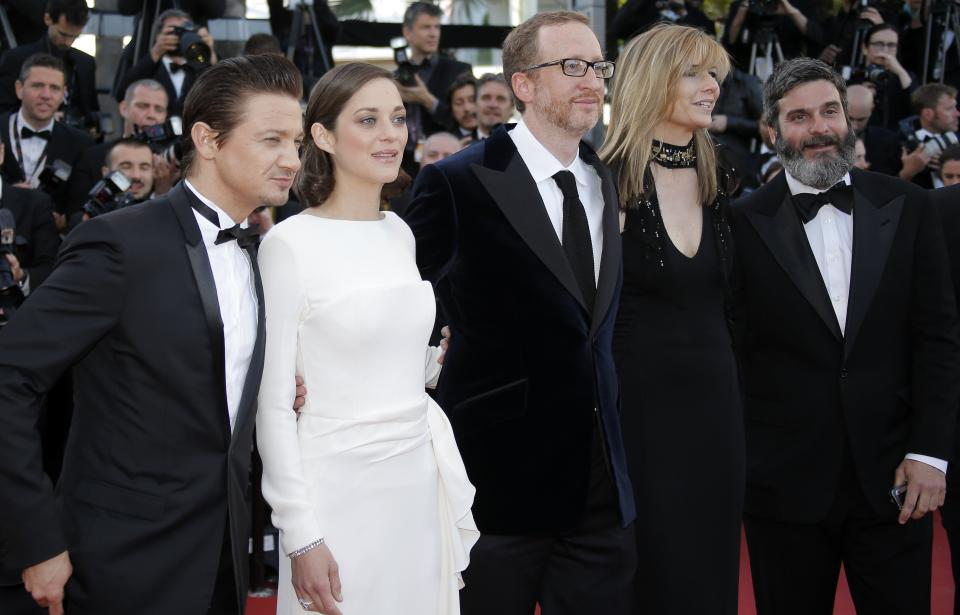 Cast members from left, actor Jeremy Renner, actress Marion Cotillard, director James Gray and his wife Ali Gray and producer Anthony Katagas arrive for the screening of The Immigrant at the 66th international film festival, in Cannes, southern France, Friday, May 24, 2013. (AP Photo/Lionel Cironneau)