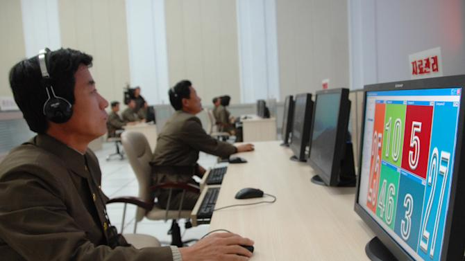 Scientists and technicians work on their computers to control the launch of North Korea's Unha-3 rocket at the General Satellite Control and Command Center on Wednesday, Dec. 12, 2012, in Pyongyang, North Korea. North Korea successfully fired the long-range rocket on Wednesday, defying international warnings as the regime of Kim Jong Un took a big step forward in its quest to develop a nuclear missile. (AP Photo)