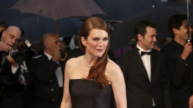 Actress Julianne Moore arrives for the opening ceremony and the screening of The Great Gatsby at the 66th international film festival, in Cannes, southern France, Wednesday, May 15, 2013. (Photo by Joel Ryan/Invision/AP)
