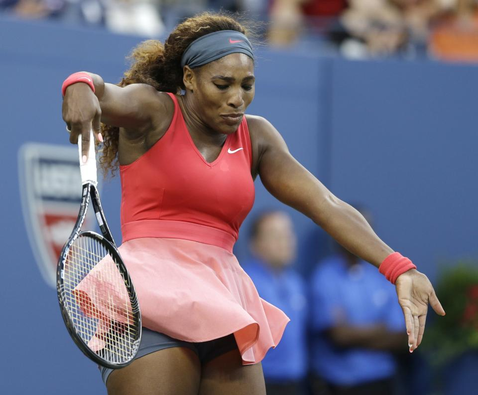 Serena Williams reacts after a point to Victoria Azarenka, of Belarus, during the women's singles final of the 2013 U.S. Open tennis tournament, Sunday, Sept. 8, 2013, in New York. (AP Photo/Darron Cummings)