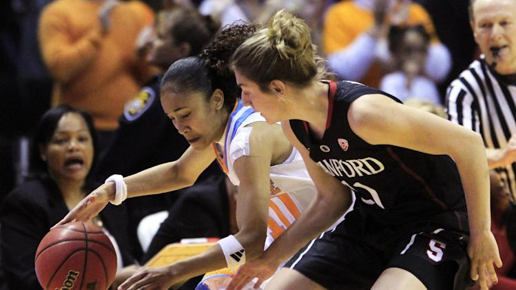 Tennessee guard Meighan Simmons. left, drives against Stanford guard Toni Kokenis (31) in the first half of an NCAA college basketball game on Saturday, Dec. 22, 2012, in Knoxville, Tenn. (AP Photo/Wade Payne)