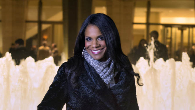 """In this photo provided by """"Live from Lincoln Center,"""" Broadway star Audra McDonald poses for a portrait in front of the Lincoln Center in New York. PBS said Tuesday, Nov. 27, 2012, that the singer-actress is the new host of """"Live from Lincoln Center."""" McDonald will emcee seven broadcasts from December through spring 2013, starting Dec. 13 with """"The Richard Tucker Opera Gala."""" (AP Photo/""""Live from Lincoln Center,"""" Chase Newhart)"""