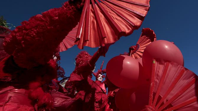 Artists perform during the flower parade as part of the carnival in Nice