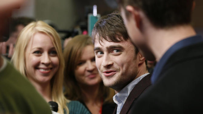 """Actor Daniel Radcliffe is interviewed at the premiere of """"Kill Your Darlings"""" during the 2013 Sundance Film Festival on Friday, Jan. 18, 2013 in Park City, Utah. (Photo by Danny Moloshok/Invision/AP)"""