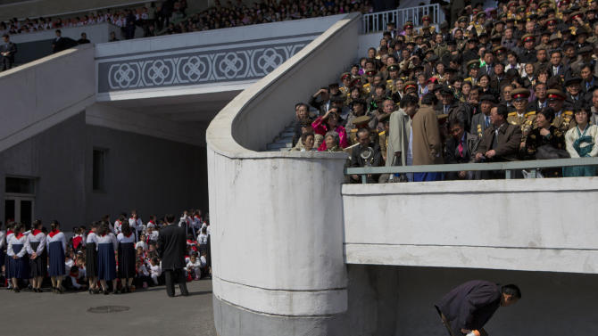 North Koreans gather in a stadium in Pyongyang to attend an induction ceremony for children into the Korean Children's Union, the first political organization for North Koreans, on Friday, April 12, 2013. (AP Photo/David Guttenfelder)