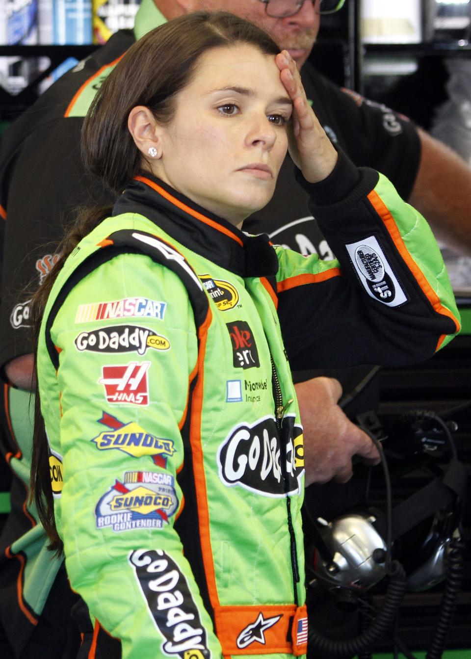 Driver Danica Patrick takes a break during practice for the Quaker State 400 NASCAR Sprint Cup series auto race at Kentucky Speedway in Sparta, Ky., Friday, June 28, 2013. (AP Photo/James Crisp)