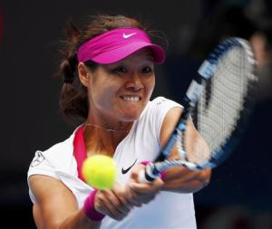 Li Na of China hits a return to Flavia Pennetta of Italy during their women's quarter-final tennis match at the Australian Open 2014 tennis tournament in Melbourne