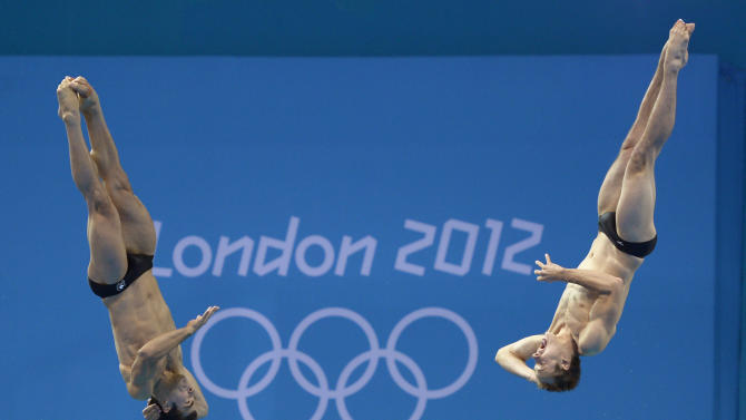 Alexandre Despatie, left, and Ross Reuben of Canada compete during the men's synchronized 3-meter springboard diving final at the Aquatics Centre in the Olympic Park during the 2012 Summer Olympics in London, Wednesday, Aug. 1, 2012. Canada took sixth in the event. (AP Photo/Mark J. Terrill)