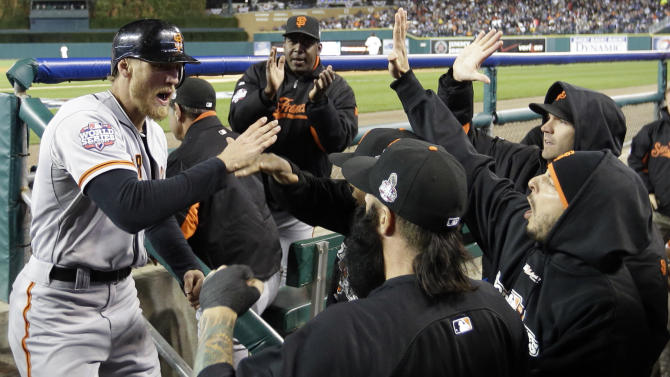 San Francisco Giants right fielder Hunter Pence, left, celebrates after scoring a run during the second inning of Game 4 of baseball's World Series against the Detroit Tigers Sunday, Oct. 28, 2012, in Detroit. (AP Photo/David J. Phillip)