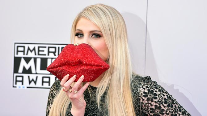 Meghan Trainor arrives at the 42nd annual American Music Awards at Nokia Theatre L.A. Live on Sunday, Nov. 23, 2014, in Los Angeles. (Photo by John Shearer/Invision/AP)