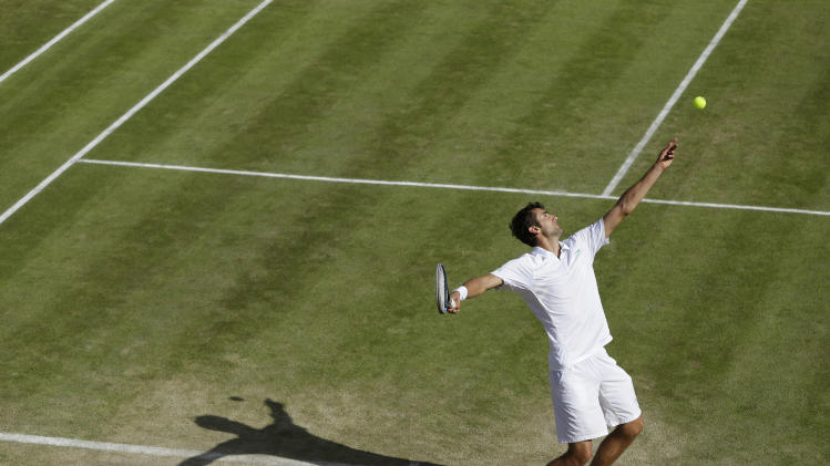 Marin Cilic of Croatia serves to Sam Querrey of the United States during a third round men's singles match at the All England Lawn Tennis Championships at Wimbledon, England, Saturday, June 30, 2012. (AP Photo/Kirsty Wigglesworth)