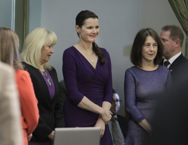Actress Geena Davis, center, smiles a she waits to be escorted into the Assembly by Assembly Minority Leader Connie Conway, R-Tulare, left, and Assemblywoman Nancy Skinner, D-Berkeley, at the Capitol in Sacramento, Calif., Monday, March 4, 2013. Davis says remarks containing disrespect for women from the host of last months Academy Awards ceremony overshadowed the win of an animated film with a strong female character. (AP Photo/Rich Pedroncelli)