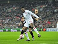 England&#39;s Danny Welbeck (L) is challenged by John Heitinga of The Netherlands during an international friendly at Wembley Stadium in London on February 29. Welbeck and Glen Johnson were both passed fit to play at Euro 2012 after being included in England&#39;s final 23-man squad for the tournament on Tuesday