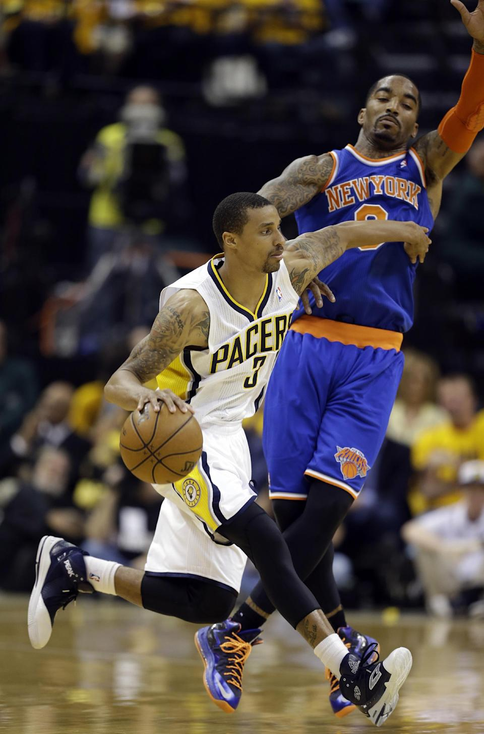 Indiana Pacers' George Hill (3) tries to drive past New York Knicks' J.R. Smith during the first half of Game 6 of an Eastern Conference semifinal NBA basketball playoff series Saturday, May 18, 2013, in Indianapolis. (AP Photo/Darron Cummings)