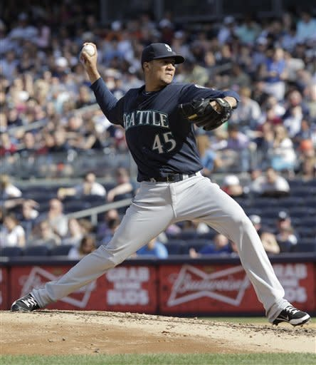 Hughes pitches into 8th to lead Yankees over M's