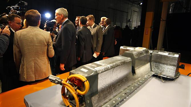 FILE - In this file photograph taken Jan. 7, 2010, former General Motors Chairman and CEO Ed Whitacre addresses the media next to the first lithium-ion battery off the assembly line for the Chevrolet Volt at the Brownstown Battery Pack Assembly in Brownstown Township, Mich. General Motors said Monday, Nov. 28, 2011, it will offer free loaner cars to Chevrolet Volt owners if they're concerned about the cars catching fire.(AP Photo/Carlos Osorio, File)