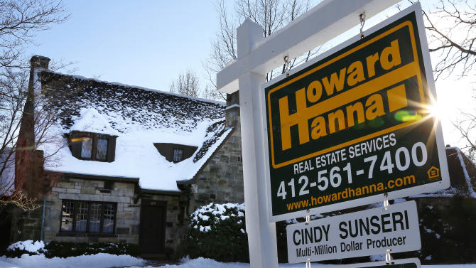 In this Thursday, Jan. 3, 2012 photo, a home is for sale in Mount Lebanon, Pa. Freddie Mac reports on mortgage rates for the second week of February on Thursday, Feb. 14, 2013.  (AP Photo/Gene J. Puskar)