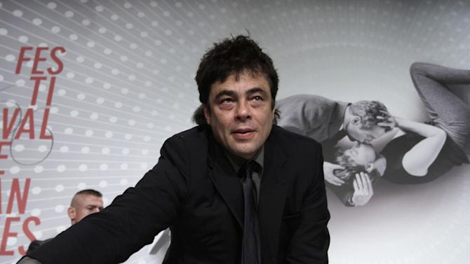 Actors Benicio Del Toro takes his place during a press conference for Jimmy P. Psychotheraphy of a Plains Indian at the 66th international film festival, in Cannes, southern France, Saturday, May 18, 2013. (AP Photo/Virginia Mayo)