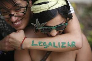 File photo of a woman embracing her friend during a rally to demand the legalization of marijuana in Mexico City