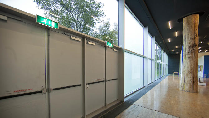 The exit doors used to take seven stolen paintings out of Kunsthal museum are seen in Rotterdam, Wednesday Oct. 17, 2012, as the museum opened it's door to the public following early Tuesday morning's heist. Police investigating a multimillion euro (dollar) art heist say they are following up several tips from the public, a day after thieves grabbed seven paintings from the walls of a Rotterdam gallery and vanished into the night. A spokeswoman for detectives on the case, Willemieke Romijn, said Wednesday they have some 15 tips from the public, following a late-night, nationally televised appeal for witnesses to the theft from the Kunsthal gallery of works by celebrated artists including Pablo Picasso, Claude Monet and Henri Matisse. (AP Photo/Peter Dejong)