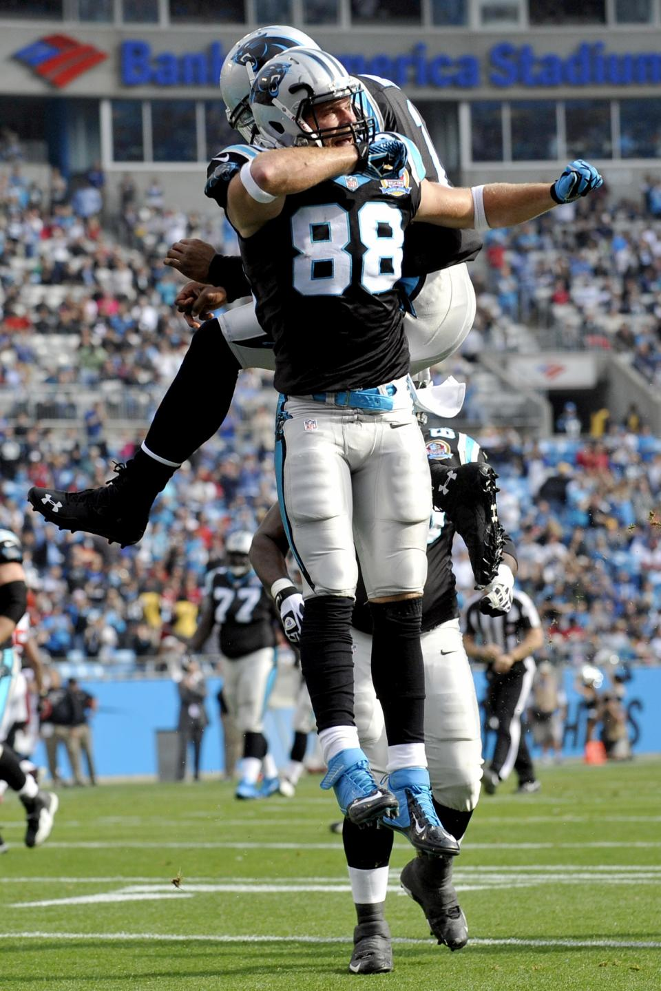 Carolina Panthers' Greg Olsen (88) and Cam Newton (1) celebrate Olsen's touchdown catch against the Atlanta Falcons during the first half of an NFL football game in Charlotte, N.C., Sunday, Dec. 9, 2012. (AP Photo/Rainier Ehrhardt)