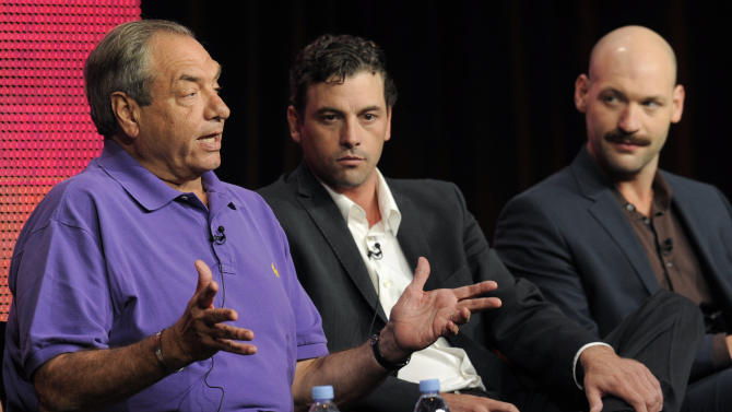 """FILE -- A July 30, 2010 file photo shows Dick Wolf, left, executive producer of """"Law & Order: Los Angeles,"""" with cast members Skeet Ulrich, center, and Corey Stoll during the NBC Universal Television Critics Association summer press tour in Beverly Hills, Calif.  The plot on the Wednesday Dec. 1, 2010 """"Law & Order: Los Angeles"""" includes a philandering golf star and his club-wielding wife. (AP Photo/Chris Pizzello/file)"""