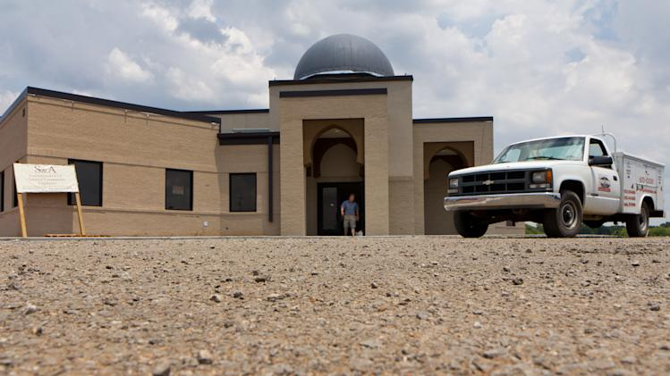 FILE - In a Thursday, June 21, 2012 file photo, a worker walks out of the construction site of a mosque being built in Murfreesboro, Tenn. The Islamic Center of Murfreesboro and its religious leader, Imam Ossama Bahloul, sued Rutherford County on Wednesday, July 18, 2012 and asked the federal court for an emergency order to let worshippers into the building before the holy month of Ramadan starts at sundown on Thursday. In May, a Rutherford County judge overturned the county's approval of the mosque construction and this month he ordered the county not to issue an occupancy permit for the 12,000-square-foot building.  (AP Photo/Erik Schelzig, File)