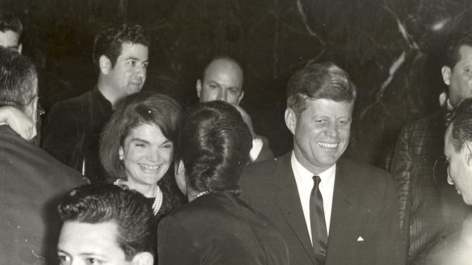 This image provide by Alexander Arroyos, taken on Nov. 21, 1963, shows President John F. Kennedy and first lady Jacqueline Kennedy greeting Latino activists at a LULAC gala in Houston's Rice Hotel. Historians say Kennedy's appearance at the Rice Ballroom _ 49 years ago this week and the night before his assassination _ was likely the first time a U.S. president officially acknowledged Latinos as an important voting block.  (AP Photo/Courtesy of Alexander Arroyos)