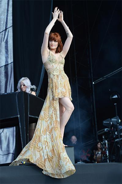 On Day 2 of the BBC Radio 1 Hackney Weekend, Florence floated around the stage, barefoot and breathtaking, in a floral print Julien Macdonald high-low gown with nude tulle overlay and embroidered lace