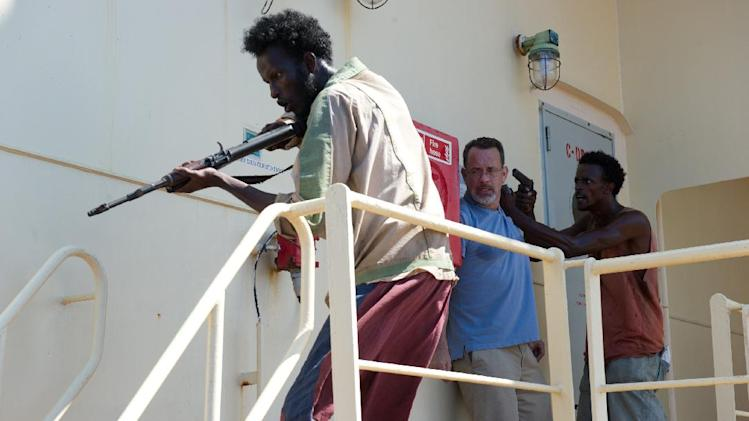 "This film image released by Sony - Columbia Pictures shows, from left, Mahat Ali, Tom Hanks and Faysal Ahmed in a scene from ""Captain Phillips."" (AP Photo/Sony - Columbia Pictures)"