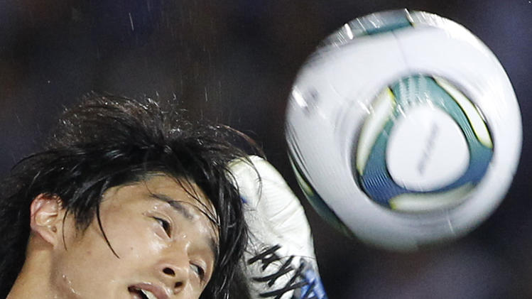 Japanese Atsuto Uchida fights for the ball with the Czech Republic's David Lafata during their friendly soccer match in Yokohama, Japan, Tuesday, June 7, 2011. (AP Photo/Shizuo Kambayashi)