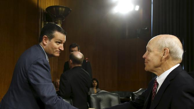 Republican presidential candidate, Sen. Ted Cruz shakes hands with  Internal Revenue Service Commissioner John Koskinen before a Senate Judiciary Oversight Subcommittee hearing in Washington