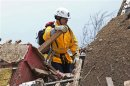 A rescue worker checks the rubble in a residential area in Moore, Oklahoma