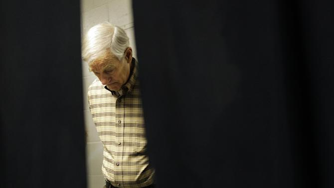 FILE - This Feb. 18, 2012 file photo shows then-Republican presidential candidate Rep. Ron Paul, R-Texas waiting backstage as he prepares to speak at CenturyLink Arena in Boise, Idaho. Ron Paul is exiting the political stage but his legions of rabble-rousing followers insist they are only getting started.  Libertarian-leaning loyalists of the two-time Republican presidential candidate have quietly taken over key-state GOP organizations, ensuring future fights with the GOP's establishment and laying the groundwork for a future presidential candidate.  (AP Photo/Marcio Jose Sanchez, File)