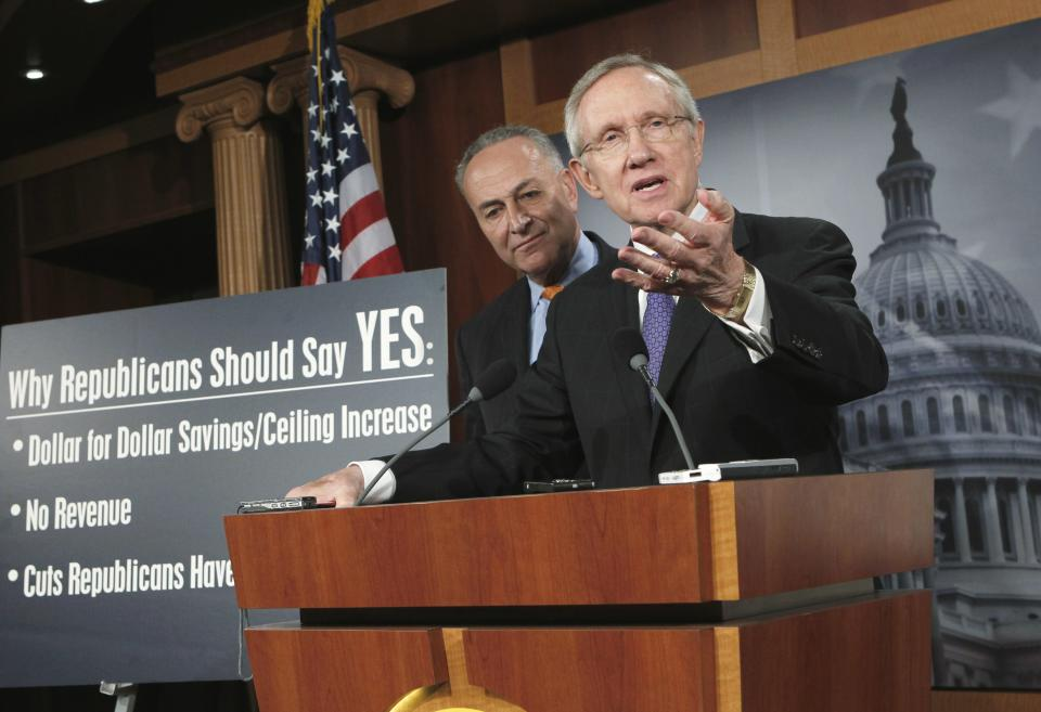 Senate Majority Leader Harry Reid of Nev., right, accompanied by Sen. Charles Schumer, D-N.Y., speaks to reporters on Capitol Hill in Washington, Monday, July 25, 2011, as they announce a new proposal to solve the debt limit crisis. (AP Photo/J. Scott Applewhite)