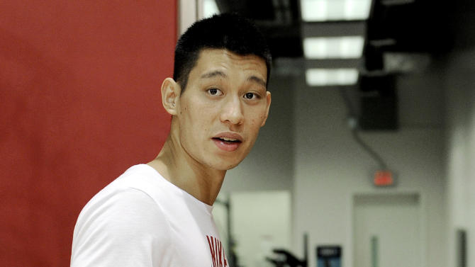 Houston Rockets' Jeremy Lin heads to the workout room after speaking with the media after NBA basketball practice, Tuesday, Sept. 18, 2012, in Houston. (AP Photo/Pat Sullivan)