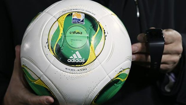 ngmar Bretz, GoalRef Sports Technology Programme Manager, holds a ball and wrist watch for a goal-line technology system by the FIFA-selected provider GoalRef (Reuters)