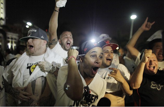 Miami Heat fans celebrate after  winning Game 6 in the NBA Finals against the San Antonio Spurs at the in Miami, on Tuesday, June 18, 2013