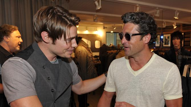 COMMERCIAL IMAGE - Actors Josh Henderson, left, and Patrick Dempsey greet each other at a John Varvatos private event featuring a Glenn Hughes performance, Saturday, July 21, 2012, in Malibu, Calif. (Photo by John Shearer/Invision for John Varvatos/AP Images)