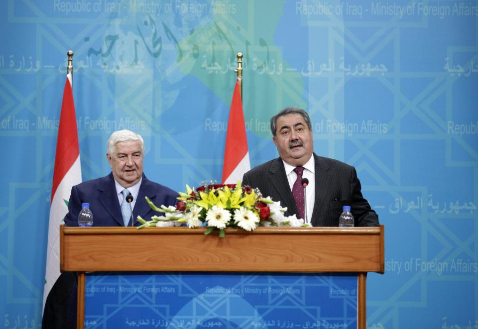 Syria's Foreign Minister Walid Moallem, left, and Iraq's Foreign Affairs Minister, Hoshyar Zebari, attend a press conference in Baghdad, Iraq, Sunday, May 26, 2013. (AP Photo/Hadi Mizban, Pool)