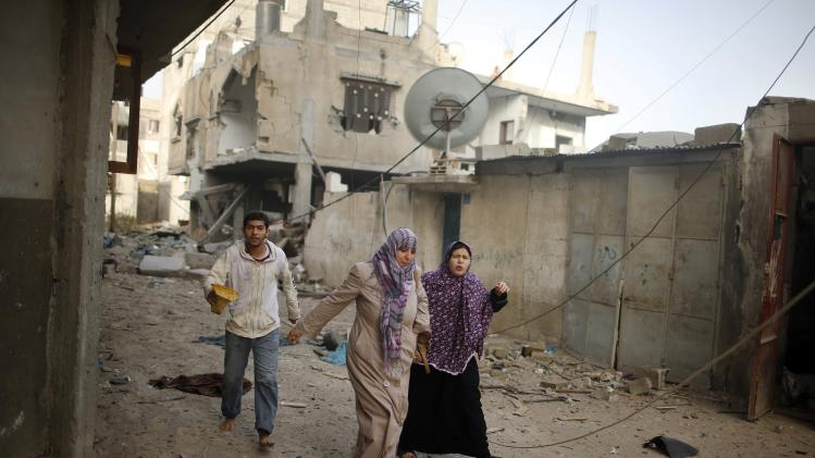 Palestinians flee their houses following what police said was an Israeli air strike on a house in the northern Gaza Strip