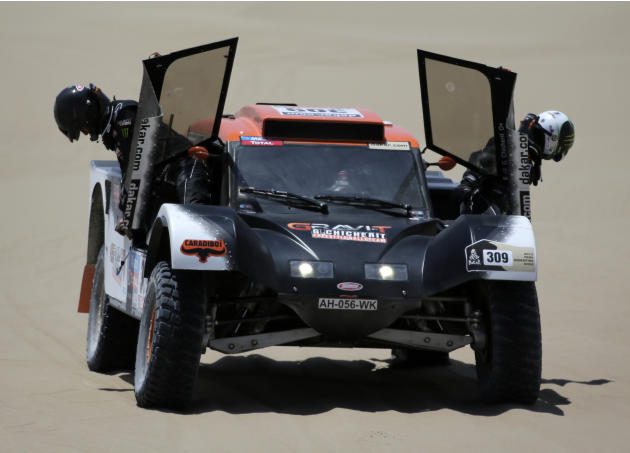 France's Guerlain Chicherit and his navigator Jean-Pierre Garcin get out from their SMG during the second stage of the Dakar Rally 2013, from Pisco to Pisco