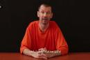 "In this still image taken from an undated video published on the Internet by Al-Furqan, the media arm of the Islamic State group militants, captive British journalist John Cantlie speaks into the camera on the first of what he says will be a series of lecture-like ""programs"" in which he says he will reveal ""the truth"" about the Islamic State group. The Arabic subtitle reads ""I am a prisoner and that is something I will not deny."" (AP Photo)"