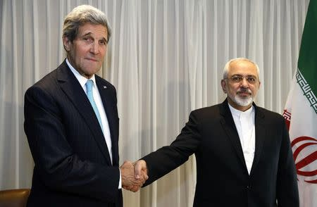 Iran's foreign minister summoned to parliament over walk with Kerry