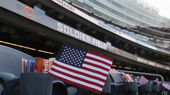 Miniature American flags are seen at each seat at Soldier Field on the 10th anniversary of the Sept. 11 attacks before an NFL football game between the Chicago Bears and Atlanta Falcons, Sunday, Sept. 11, 2011, in Chicago. (AP Photo/Charles Rex Arbogast)