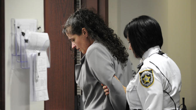 "Dee Dee Moore is led from a Hillsborough County courtroom after being found guilty of first-degree murder in the death of lottery winner Abraham Shakespeare Monday, Dec. 10, 2012 in Tampa, Fla. Moore was convicted Monday of first-degree murder in the slaying of a lottery winner in central Florida and sentenced to mandatory life without parole by a judge who called her ""cold, calculating and cruel.""(AP Photo/The Tampa Tribune, Chris Urso, Pool)"