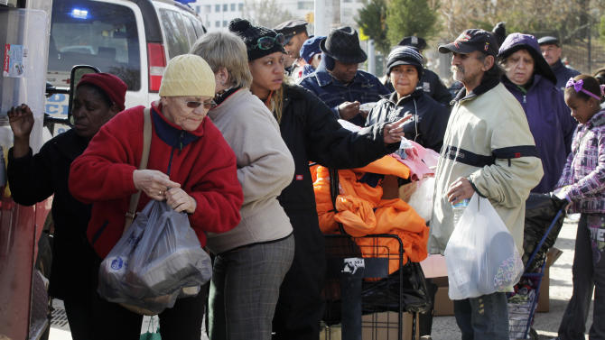 Residents line up for bundles of food at an American Red Cross station in the Coney Island section of Brooklyn, Monday, Nov. 5, 2012 in New York. The region is still cleaning up a week after Superstorm Sandy. (AP Photo/Mark Lennihan)