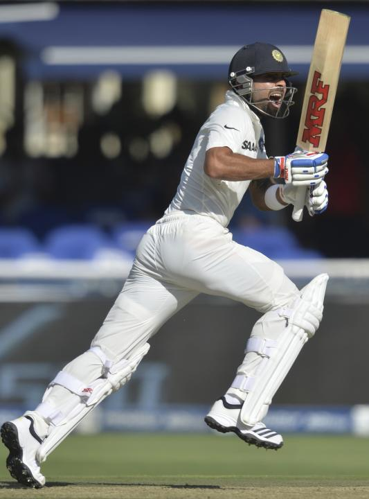 India's Kohli makes a run to reach his hundred during the first day of their cricket test match against South Africa in Johannesburg