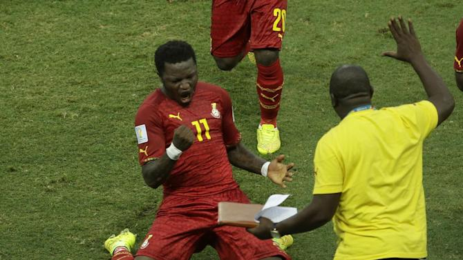 Ghana's Sulley Muntari celebrates after his team scored their second goal of the game during the group G World Cup soccer match between Germany and Ghana at the Arena Castelao in Fortaleza, Brazil, Saturday, June 21, 2014
