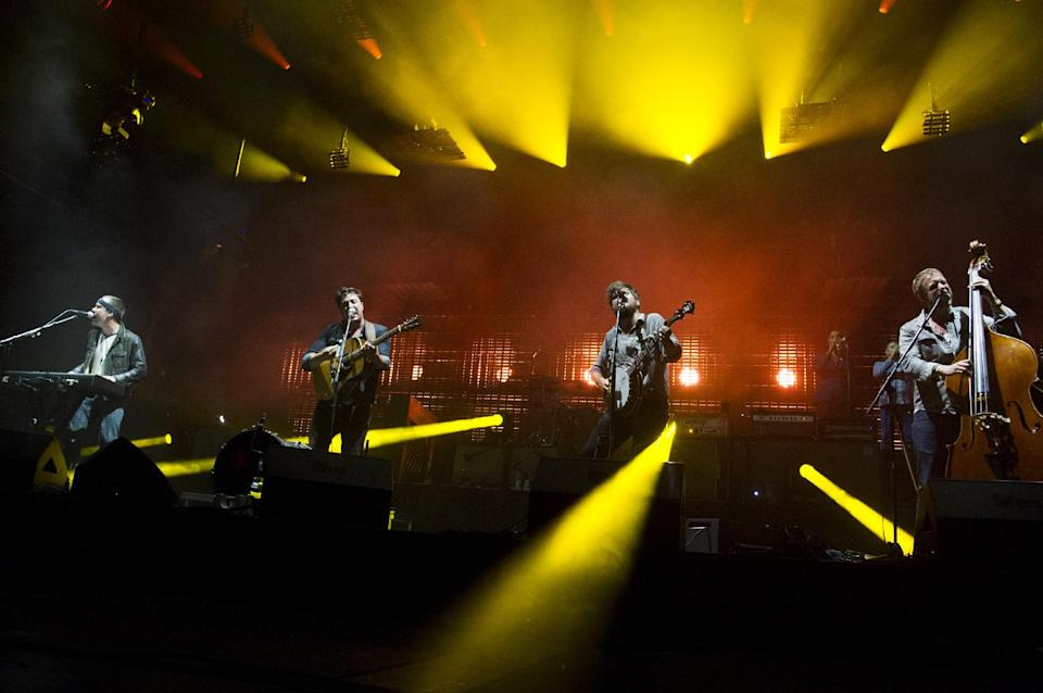 Mumford & Sons band members, from left, Ben Lovett, Marcus Mumford, Country Winston and Ted Dwane perform on Wednesday, Aug. 28, 2013 at the West Side Tennis Club in the Forest Hills neighborhood of the Queens borough of New York. (Photo by Charles Sykes/Invision/AP)